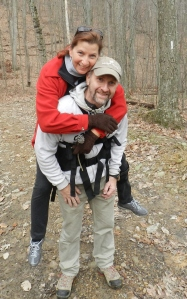 Picture of man carrying woman with the piggybackpack on a hiking trail
